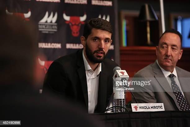 Chicago Bulls head coach Tom Thibodeau and general manager Gar Forman introduce newlysigned free agent Nikola Mirotic accompanied by guest translator...