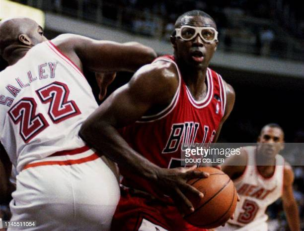 Chicago Bulls Horace Grant maneuvers around John Salley of the Miami Heat 03 December 1993 in Miammi FL Grant shot for 21 points and 11 rebounds...