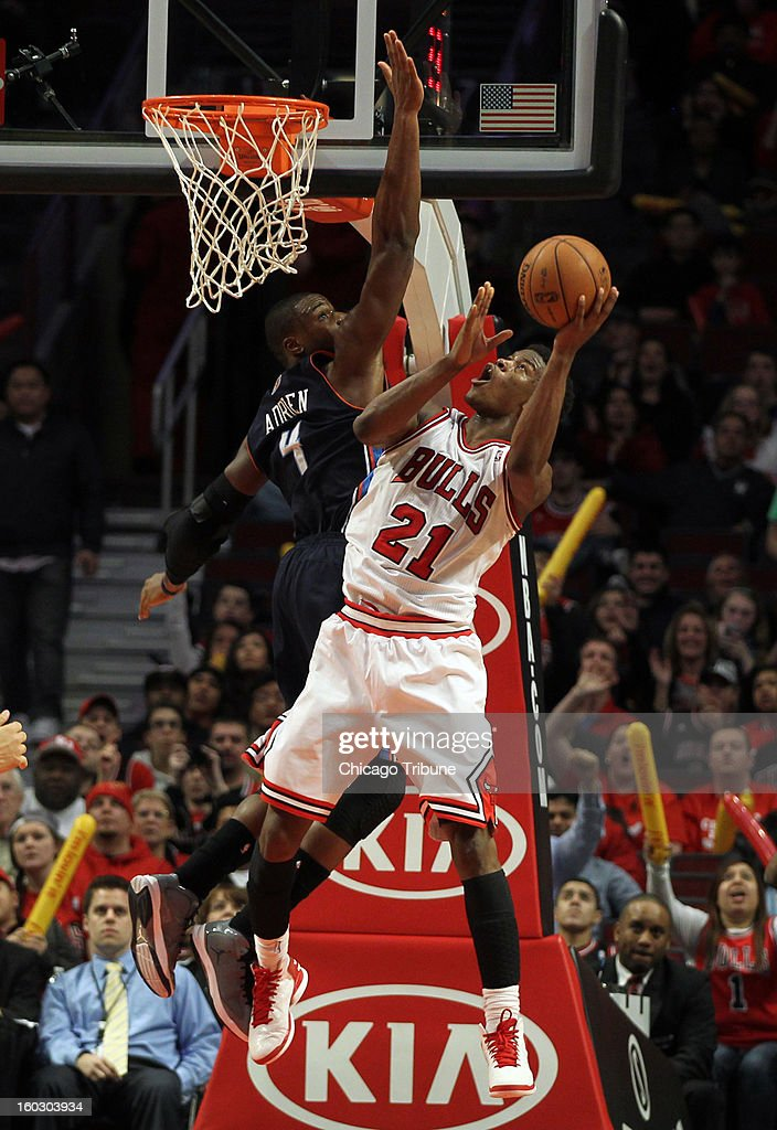 Chicago Bulls' Jimmy Butler scores against Charlotte Bobcats' Jeff Adrien in 4th quarter at the United Center in Chicago, Illinois on Monday, January 28, 2013. Bulls win, 93-85.
