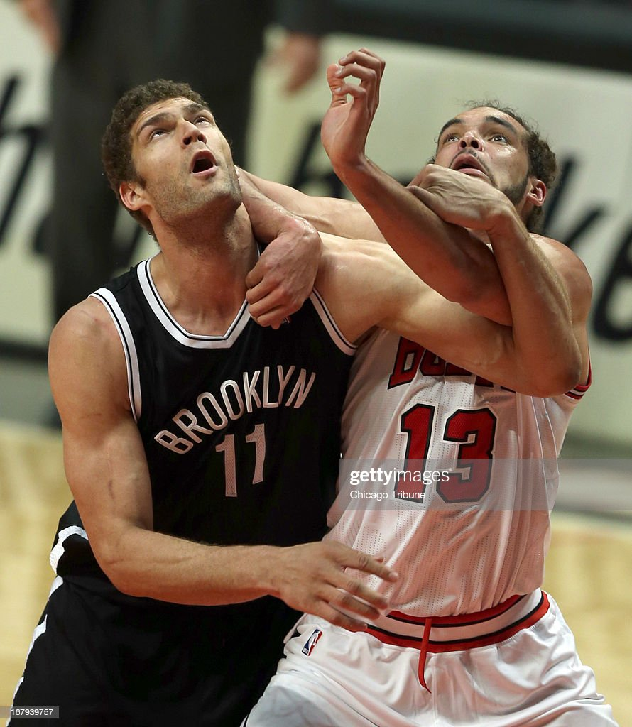 Chicago Bulls' Joakim Noah and Brooklyn Nets' Brook Lopez battle for rebound position during 1st-quarter action in Game 6 of the NBA Eastern Conference playoffs at the United Center in Chicago, Illinois, on Thursday, May 2, 2013.