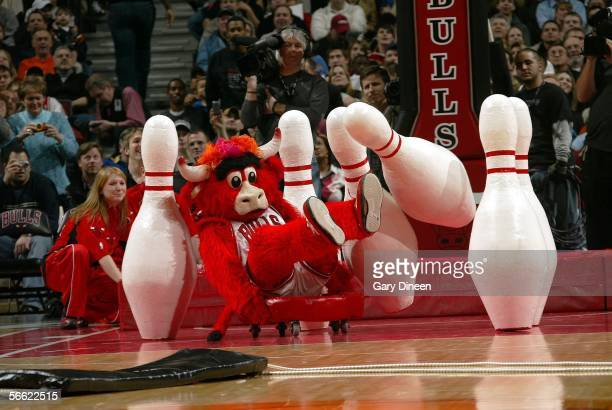 Chicago Bulls mascot Benny the Bull crashes into oversize bowling pins during a timeout in the NBA game with the New York Knicks on January 18 2006...