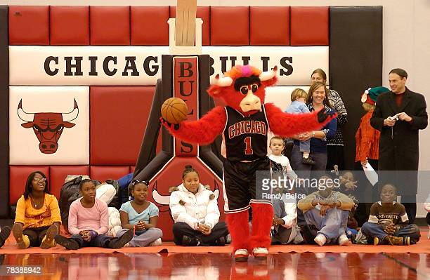 Chicago Bulls mascot Benny the Bull entertains attendees during a Chicago Bulls Holiday Party for deployed military families on December 11 2007 at...