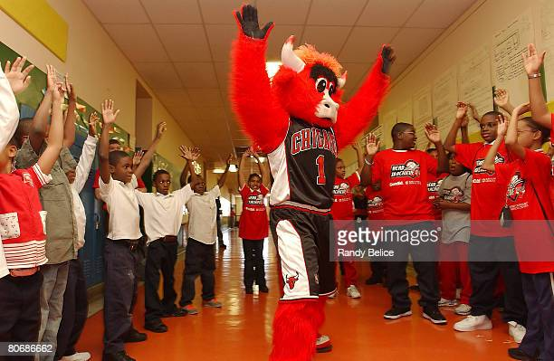 Chicago Bulls mascot Benny the Bull entertains students gathered for a ribbon cutting ceremony to officially open a new Chicago Bulls Reading and...