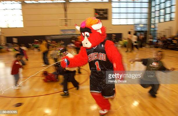 Chicago Bulls mascot Benny The Bull entertains youthful participants in attendance for the Chicago Bulls and DCFS Holiday Celebration for Intact...
