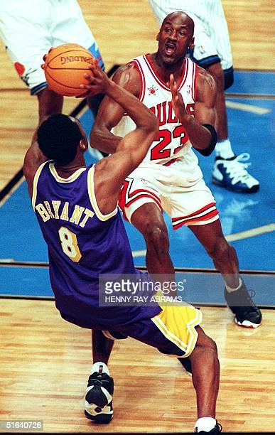 Chicago Bulls' Michael Jordan defends against Los Angeles Lakers' Kobe Bryant in the first quarter of the 1998 NBA AllStar Game at Madison Square...