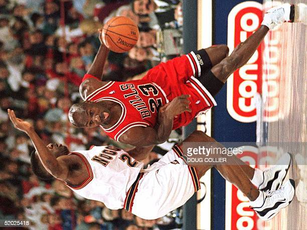 Chicago Bulls Michael Jordan drives past Denver Nuggets Johnny Newman for a layup during first period action of their NBA game 02 February at...