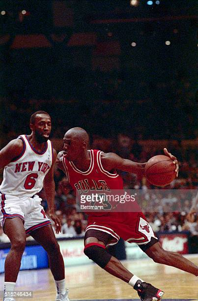 Chicago Bulls' Michael Jordan drives past the New York Knicks Trent Tucker during the second half of the Bulls' 10394 win to sweep their opening...