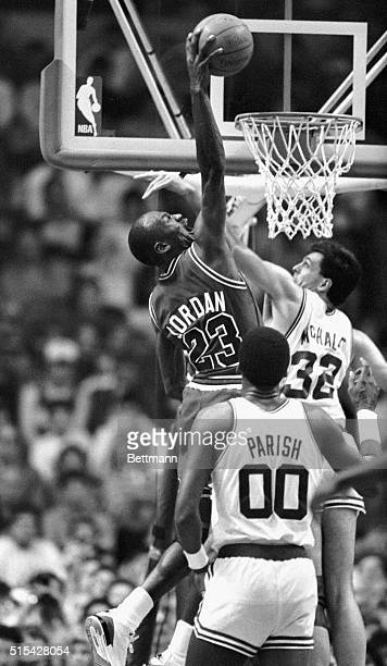 Chicago Bulls' Michael Jordan gets set to stuff ball over Celtics' Kevin McHale during 3rd quarter action of game at Boston Garden 3/20 Boston won...
