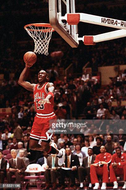 Chicago Bulls' Michael Jordan stuffs the basketball through the basket as the Knicks' Maurice Cheeks watches helplessly as Madison Square Garden 2/14.