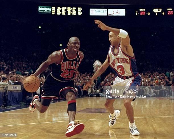 Chicago Bulls' Michael Jordan tries to get past New York Knicks John Starks.,