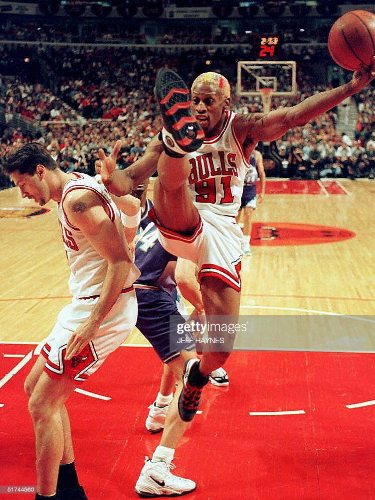 0f7885aa850 Chicago bulls player dennis rodman kicks his leg in the air as jpg 752x1004 Dennis  rodman