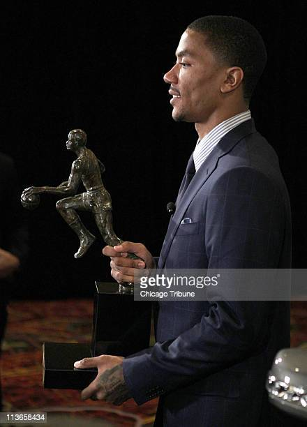 Chicago Bulls player Derrick Rose poses with the Maurice Podoloff Trophy after winning the 201011 NBA Most Valuable Player Award at the Marriott...
