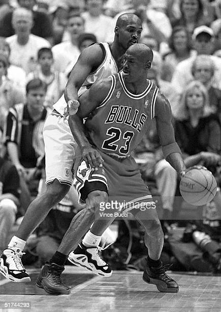 Chicago Bulls player Michael Jordan is guarded by Howard Eisley of the Utah Jazz during game four of the 1997 NBA Finals 08 June in Salt Lake City,...