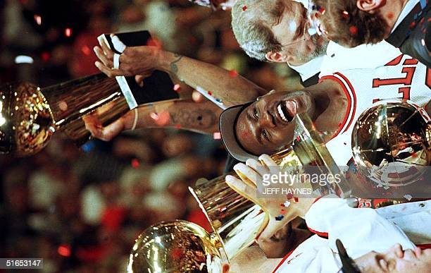 Chicago Bulls player Michael Jordan is surrounded by NBA Championship trophies after his team defeated the Utah Jazz 9086 to win the 1997 NBA Finals...
