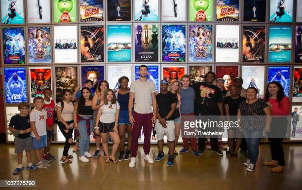 Chicago Bulls' player Zach Lavine poses with the After School Matters kids during a special screening of the basketball movie Space Jam at ArcLight...