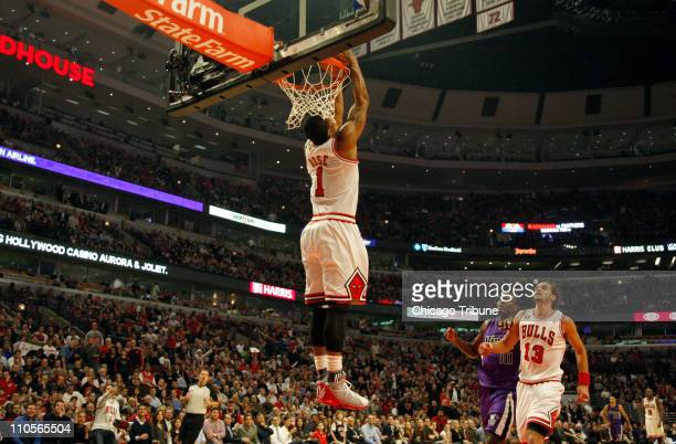 Chicago Bulls point guard Derrick Rose does a reverse dunk during the first half against the Sacramento Kings at the United Center in Chicago...