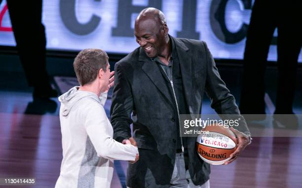 Chicago Bulls President/COO Michael Reinsdorf Jr accepts the ceremonial AllStar ball from Charlotte Hornets Chairman Michael Jordan at the 68th NBA...