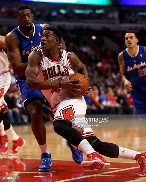 Chicago Bulls shooting guard Jimmy Butler drives against Los Angeles Clippers center DeAndre Jordan in the first half at the United Center in Chicago...