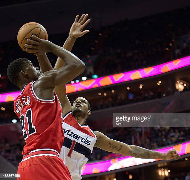 Chicago Bulls shooting guard Jimmy Butler shoots over Washington Wizards small forward Trevor Ariza during the first half of their game played at the...