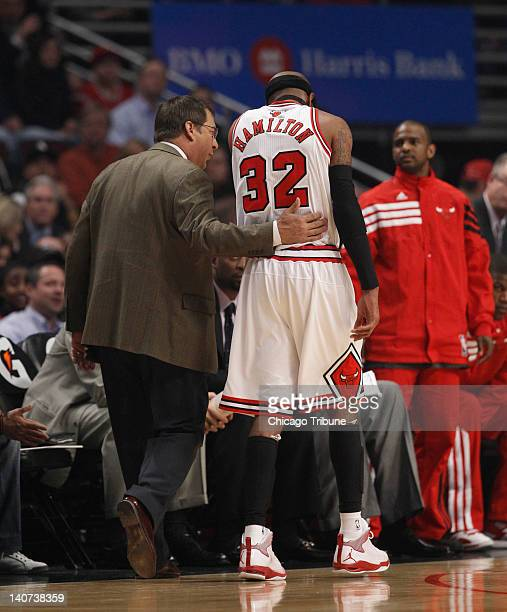 Chicago Bulls shooting guard Richard Hamilton walks off the court with the help of head athletic trainer Fred Tedeschi during the first quarter of...
