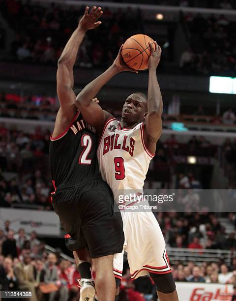 Chicago Bulls small forward Luol Deng gets a shot to the basket around Portland Trail Blazers Wesley Matthews during the fourth quarter of their game...