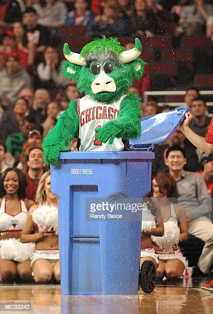 Chicago Bulls team mascot 'Benny the Bull' turns himself green for NBA's Green Week during the NBA game between the Chicago Bulls and the Charlotte...