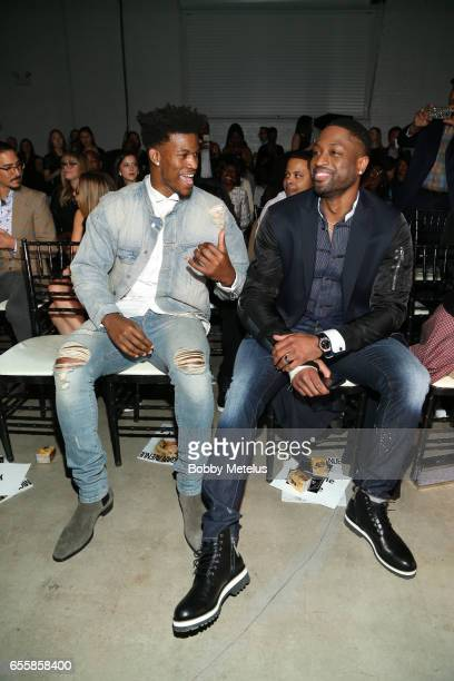 Chicago Bulls teammates Jimmy Butler and Dwyane Wade share a laughon the front row of the runway at Dwyane Wade's A Night on the Runwade Fashion...