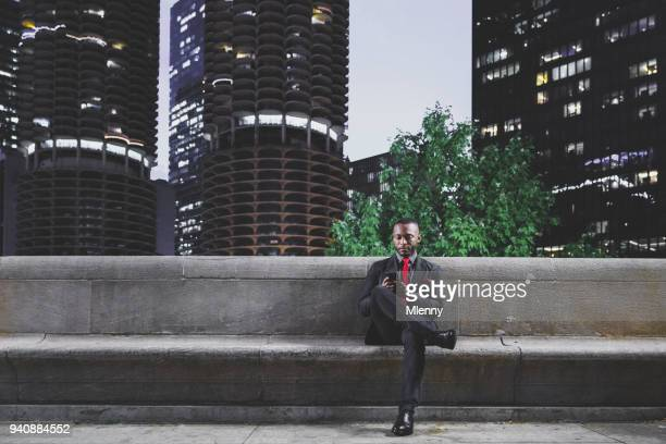 Chicago businessman checking messages