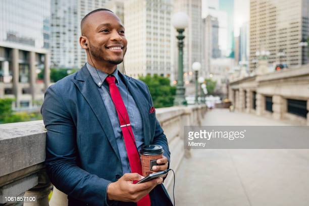 chicago businessman with headset using his mobile phone - chicago musical stock pictures, royalty-free photos & images