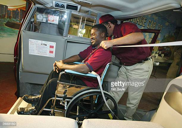 Chicago Carriage Cab taxi cab drivers William Bundy and Rafiu Ayantoye demonstrate the proper technique for transporting a disabled wheelchair client...