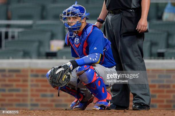 Chicago catcher Willson Contreras looks towards the dugout while displaying the Venezuelan flag on his arm during a game between the Chicago Cubs and...