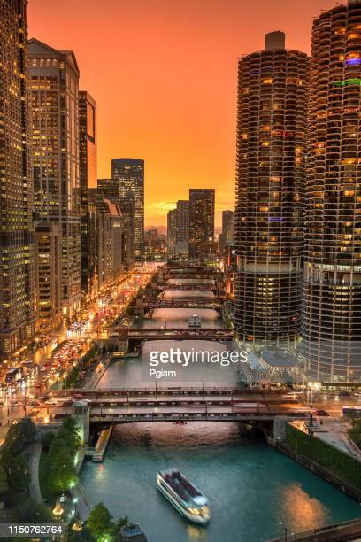 chicago cityscape and bridges over the river at night - chicago river stock pictures, royalty-free photos & images