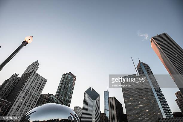 chicago cloud gate, called the bean with the skyline - cloud gate stock photos and pictures