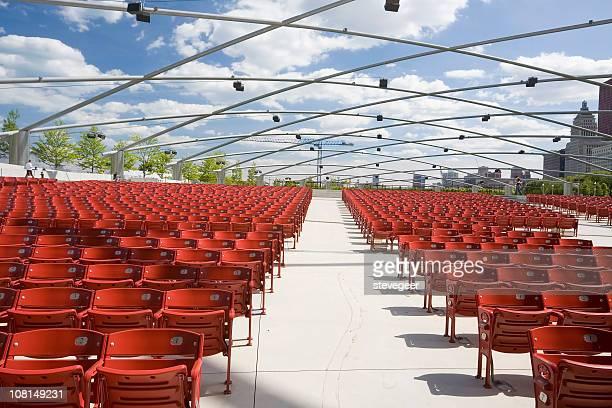 chicago concert pavillion chairs - jay pritzker pavillion stock photos and pictures