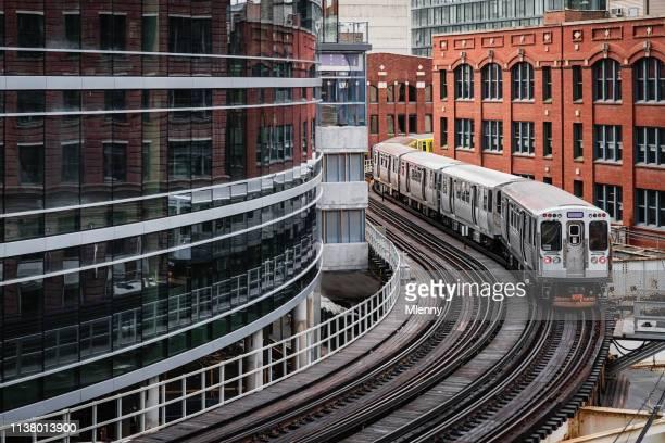 chicago cta elevated train downtown urban buildings - chicago stock-fotos und bilder
