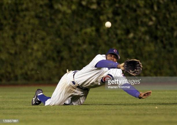 Chicago Cub center fielder, Juan Pierre robs a Washington National batter of an extra base hit during game action at Wrigley Field, Chicago, Il. On...