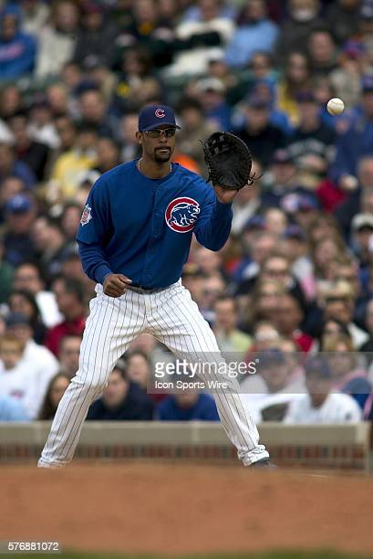 Chicago Cubs 1st Baseman Derrek Lee catches a throw from pitcher Glendon Rusch during the game against the Philadelphia Phillies at Wrigley Field in...