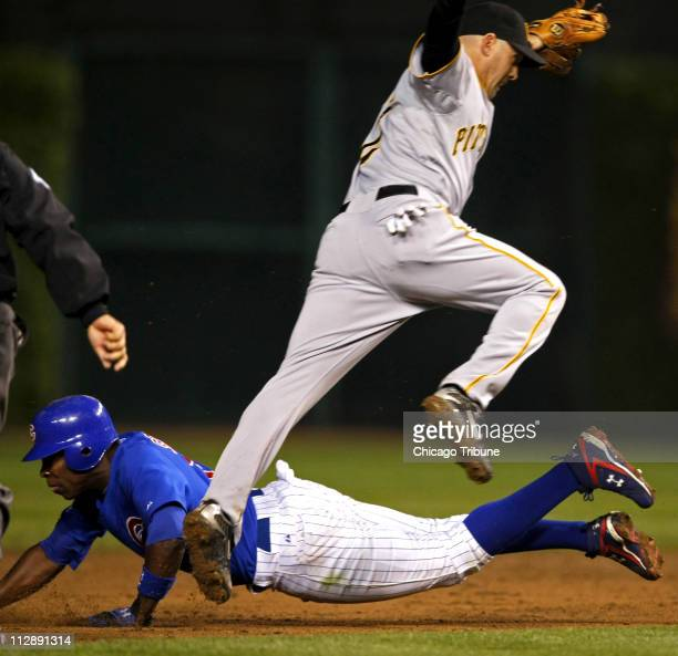 Chicago Cubs' Alfonso Soriano steals second base on Pittsburgh Pirates' Jack Wilson in fifth inning at Wrigley Field in Chicago Illinois on Tuesday...