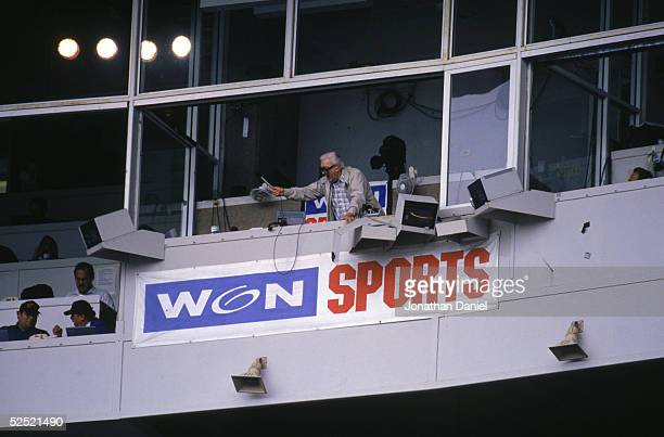 Chicago Cubs baseball announcer and Baseball Hall of Fame inductee Harry Caray conducts fans singing 'Take Me Out to the Ball Game' from his...