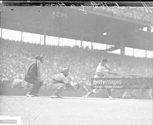Chicago Cubs baseball player Rogers Hornsby hitting a home run during a baseball game at Wrigley Field located at 1060 West Addison Street Chicago...