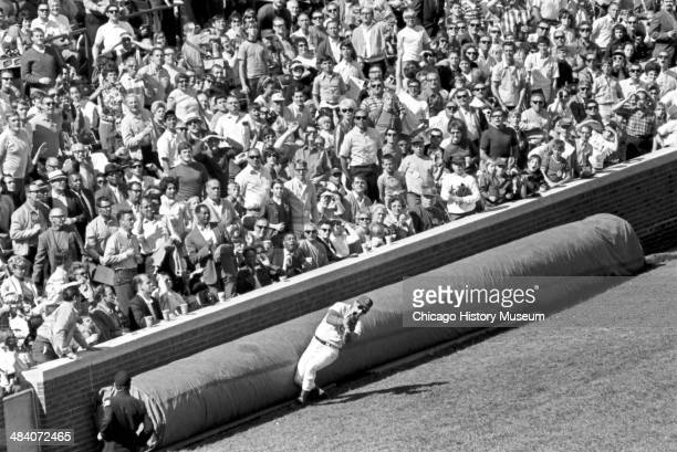 Chicago Cubs baseball player Ron Santo catching a foul ball in the fourth inning during a game against the St Louis Cardinals at Wrigley Field,...