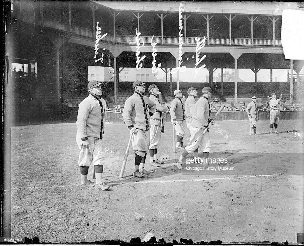 Chicago Cubs baseball players Johnny Evers, Frank Chance, Frank Schulte, Heine Zimmerman, Joe Tinker, and an unidentified player at West Side Grounds, Chicago, Illinois, 1911.