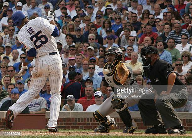 Chicago Cubs batter Derrek Lee gets out of the way of a wild pitch in the third inning that allowed teammate Craig Monroe to score from third against...