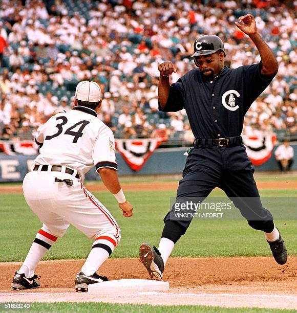 Chicago Cubs Brian McRae beats the tag from Chicago White Sox first baseman Mario Valdez in the first inning of the 16 June game at Comiskey Park in...