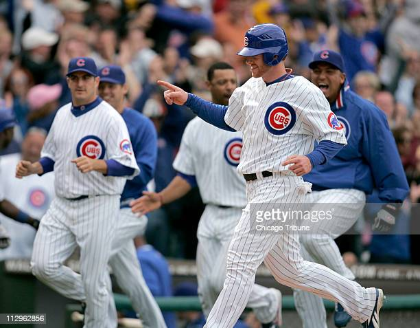 Chicago Cubs' Carlos Zambrano celebrates after teammate Daryle Ward clubs a gamewinning single in the bottom of the tenth inning against the...