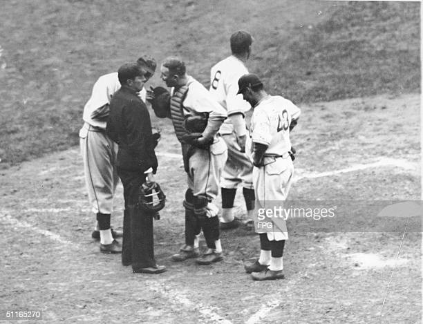 Chicago Cubs catcher Gabby Hartnett argues with Umpire Dolly Stark during the sixth inning of the fourth game of the World Series Chicago Illinois...