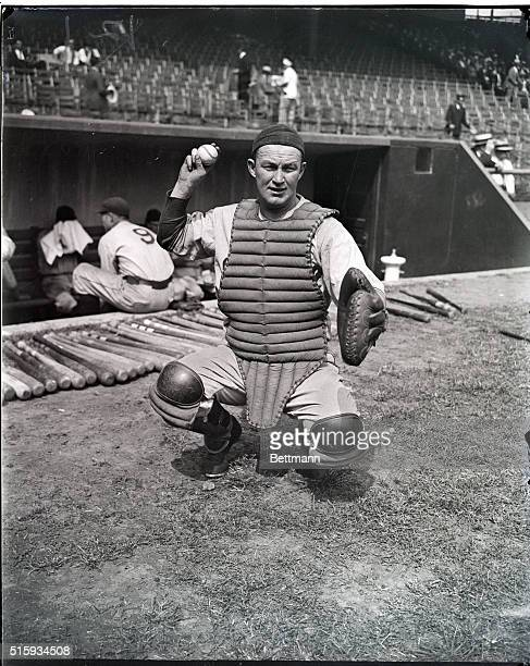 Chicago Cubs catcher Gabby Hartnett in action on the field He is shown kneeling about to release a throw