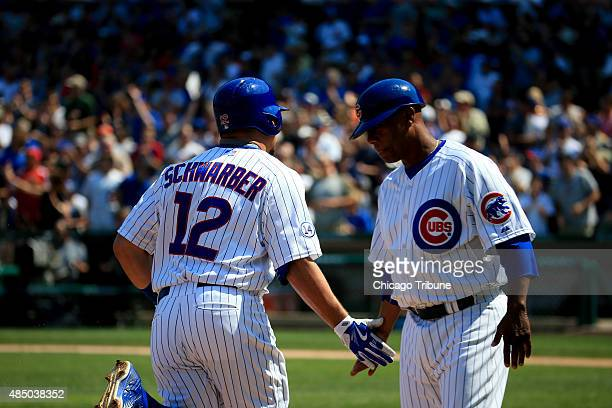 Chicago Cubs catcher Kyle Schwarber is congratulated by Chicago Cubs third base coach Gary Jones after hitting a home run during the second inning on...