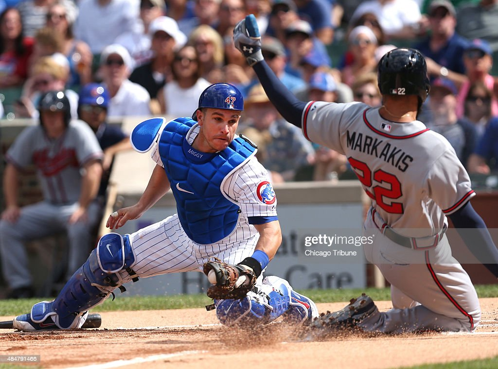 Chicago Cubs Catcher Miguel Montero 47 Is Unable To Tag Out Atlanta Braves Baserunner
