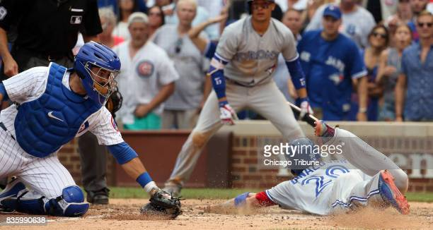 Chicago Cubs catcher Rene Rivera can't make the tag as Toronto Blue Jays shortstop Josh Donaldson scores in the 10th inning on Sunday Aug 20 2017 at...